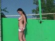 Busty brunette babe strips outdoor