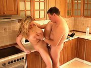 Sexy busty housewife likes fucking with this experienced horny man in her kitchen.